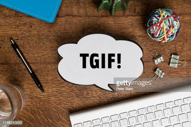 view from above paper tgif speech bubble on wooden desk - friday stock pictures, royalty-free photos & images
