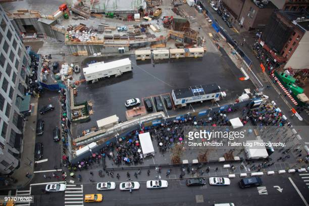 View from above - People Waiting to Enter Sept 11th Memorial in the Rain