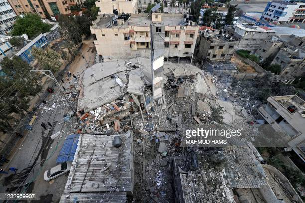 View from above shows the destroyed six-storey Kuhail building which was targeted by an early morning Israeli airstrike on Gaza City on May 18, 2021....