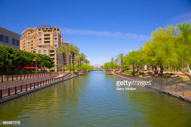 View from above water running through Arizona Canal in Scottsdale, Arizona, USA.