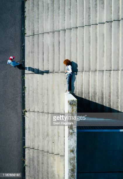 view from above young man laying on urban steps - unusual angle stock pictures, royalty-free photos & images