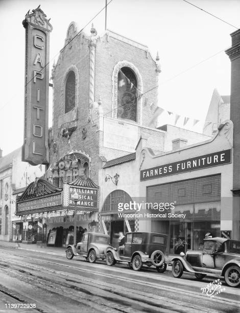 View from across the street of the Capitol Theatre tower, Madison, Wisconsin, February 5, 1930. 'Love Parade' is advertised on the marquee. Three...