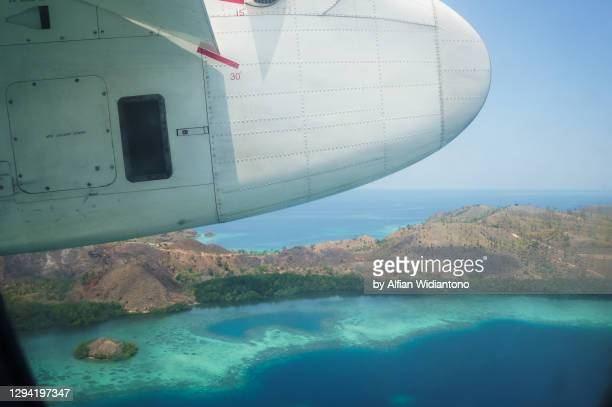 view from aircraft plane - indonesia stock pictures, royalty-free photos & images