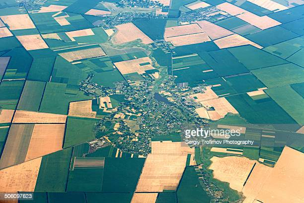 View from airplane on town and fields