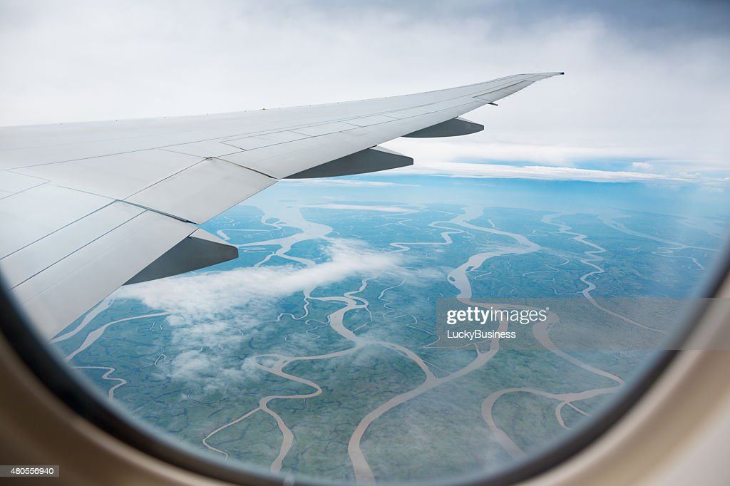 view from airplane to the ground dotted with rivers : Stock Photo