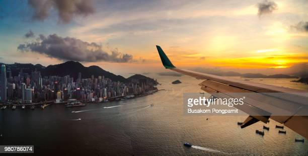 view from airplane window. flying over hong kong city - aeroplane stock pictures, royalty-free photos & images