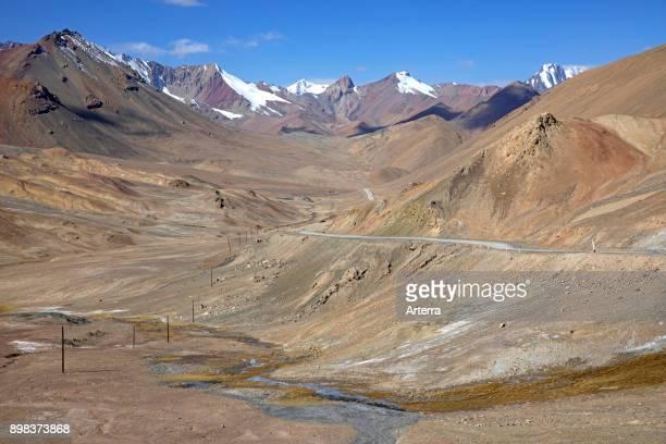 View from AkBaital Pass highest mountain pass at 4655 metres on Pamir Highway / M41 in the Pamir Mountains GornoBadakhshan province Tajikistan