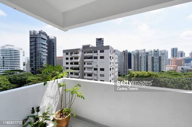 view from an apartment balcony in singapore - apartment balcony stock pictures, royalty-free photos & images