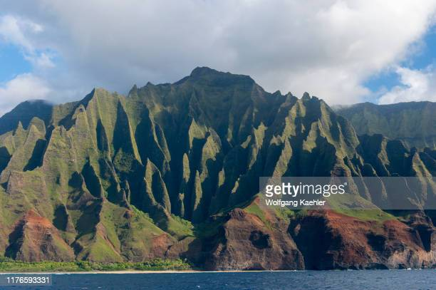 View from an excursion boat of the Na Pali coast on the western side of the Hawaiian Island of Kauai Hawaii USA