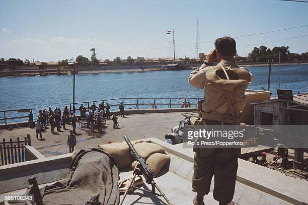 View from an observation post of Israeli troops and members of the Israel Defense Forces standing beside the Suez Canal after advancing across the...