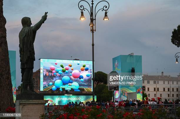 View from an official fan zone at the Roman Forum in Rome on June 11 shows a giant screen displaying the EURO 2020 2021 European Football...