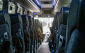 View from back seat at coach bus, more seats in blurred background