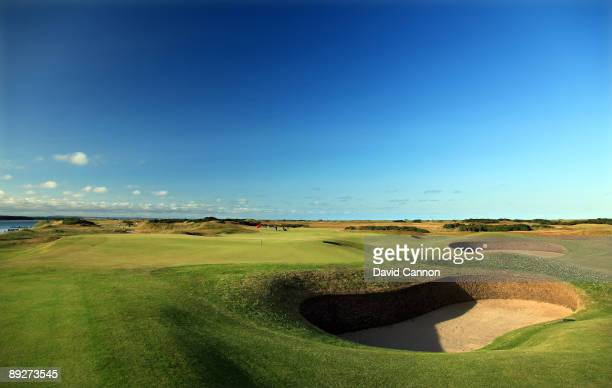 A view from behind and left of the green on the par 3 11th hole with the green of the par 4 7th hole behind on the Old Course on July 11 2009 in St...