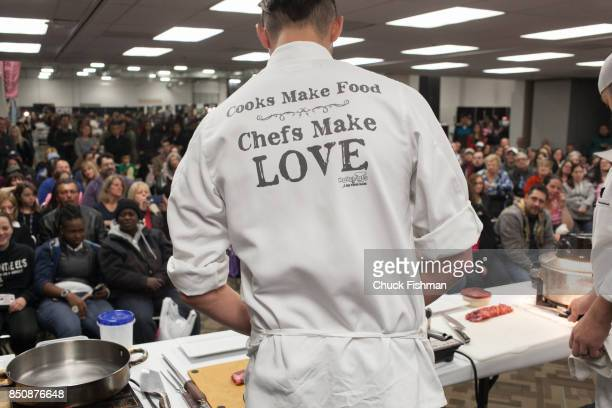 View from behind as an unidentified chef presents a cooking demonstration for a large audience during the Chocolate Expo at the Westchester County...