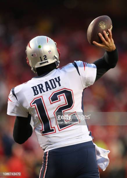 A view from behind as New England Patriots quarterback Tom Brady throws a pass in warm ups before the AFC Championship Game game between the New...