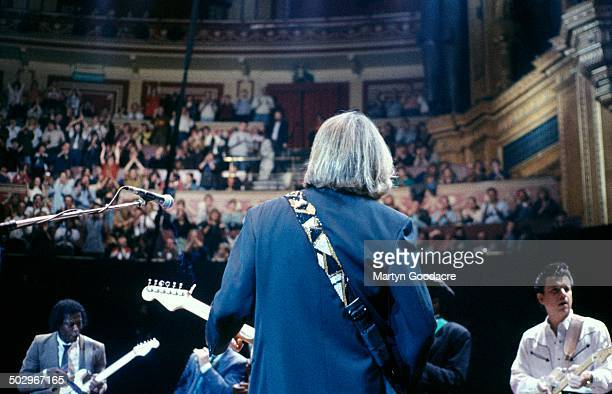 A view from behind Eric Clapton showing Buddy Guy and Jimmie Vaughan as they perform on stage at Blues Night at the Royal Albert Hall London United...