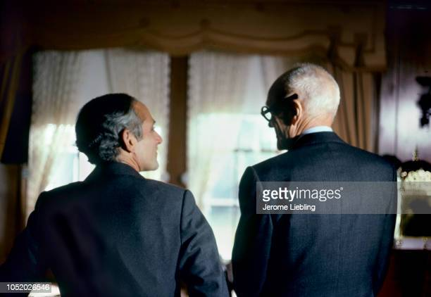 View from behind of American architects Robert AM Stern and Philip Johnson as they look at each other in the HillStead Museum Farmington Connecticut...