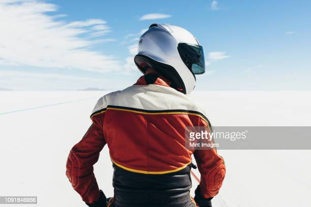 view from behind of motorcyclist at start line on the salt flats - sports helmet stock pictures, royalty-free photos & images