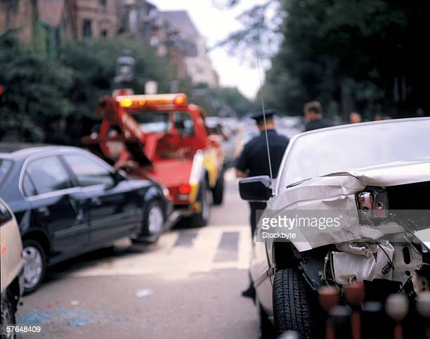view from behind of the smashed rear of a car - tow truck stock pictures, royalty-free photos & images
