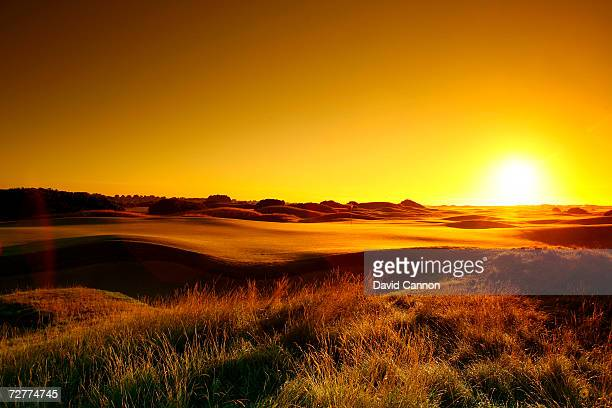 A view from behind the green at sunrise on the 520 yds par 5 6th hole 'Hogan's Alley' on the Carnoustie Championship Course venue for the 2007 Open...