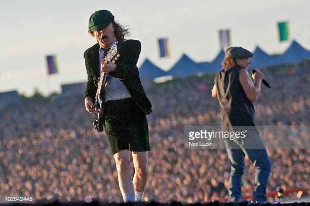 View from behind the stage of Angus Young and Brian Johnson of AC/DC performing on the first day of the Download Festival at Donington Park on June...