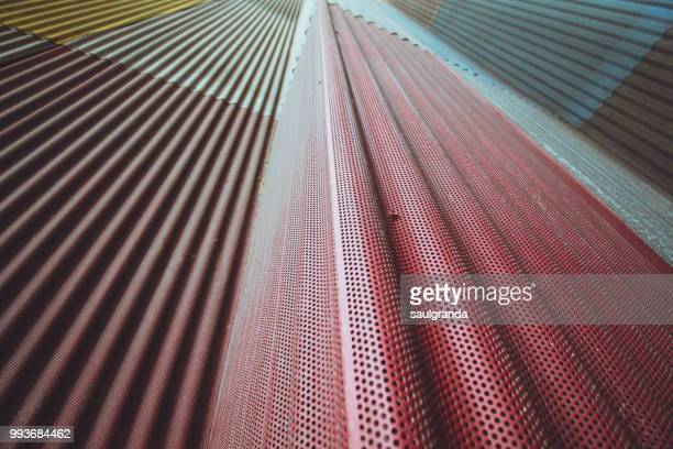 View from bellow of colorful metallic planks on a facade