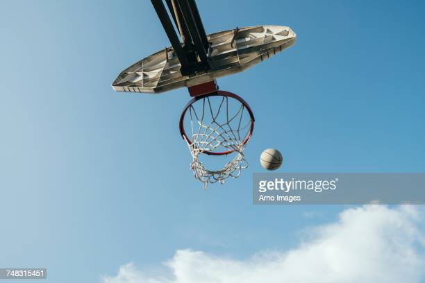 view from below basketball net and basketball - point scoring stock pictures, royalty-free photos & images