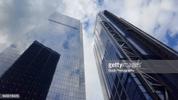 """view from below of """"3 world trade center"""" (right) and of another office tower at the world trade center site in lower manhattan, new york city - number 3 stock pictures, royalty-free photos & images"""