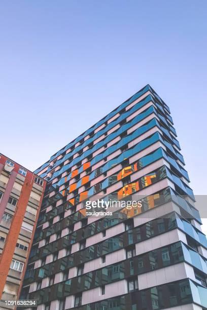 view from below of a modern glass building - gijón - fotografias e filmes do acervo