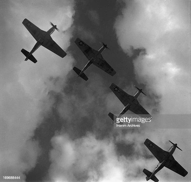 View from below of four P51 Mustangs flying in formation near Ramitelli airbase in Italy March 1945