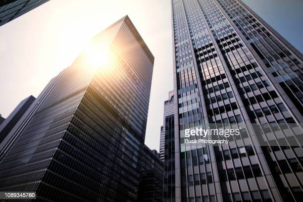 view from below of highrise office towers in midtown manhattan, new york city, usa - finance and economy stock pictures, royalty-free photos & images