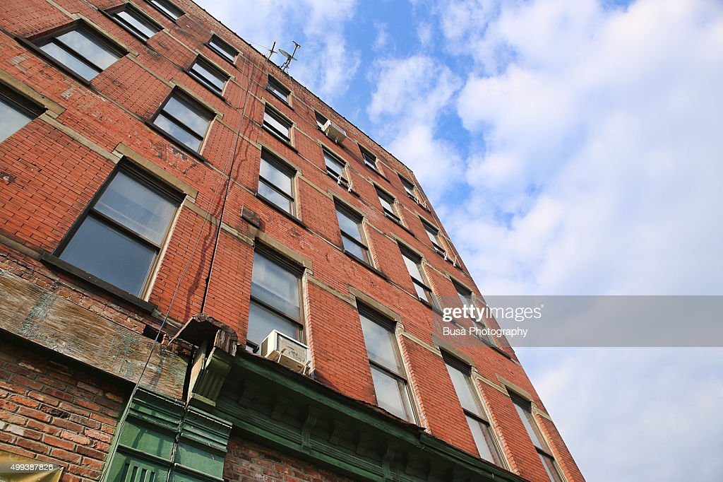 View From Below Of Red Brick Building In The Lower East Side Manhattan New York City
