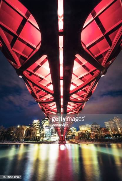 view from below the peace bridge in calgary - calgary stock pictures, royalty-free photos & images