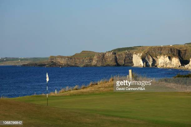 A view from beside the green looking towards Dunluce Castle on the 382 yards par 4 fifth hole 'White Rock' on the Dunluce Links at Royal Portrush...