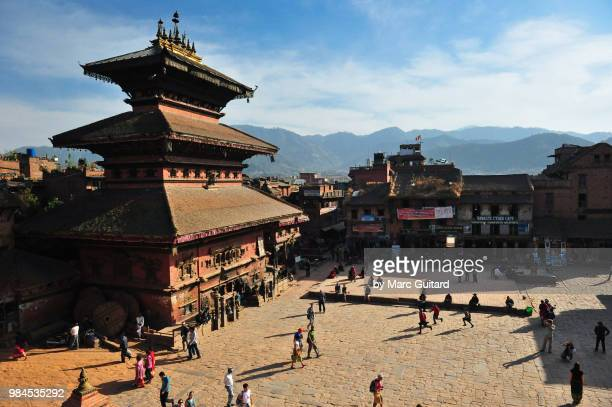 a view from bhairab temple over a town square with the himalayan foothills in the background, bhaktapur, kathmandu valley, nepal - kathmandu stock pictures, royalty-free photos & images