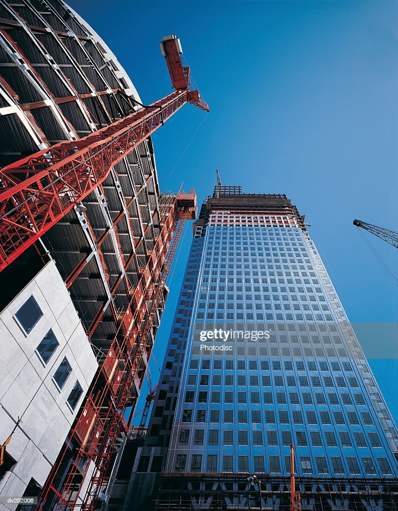 View from bottom of building of construction : Stock Photo