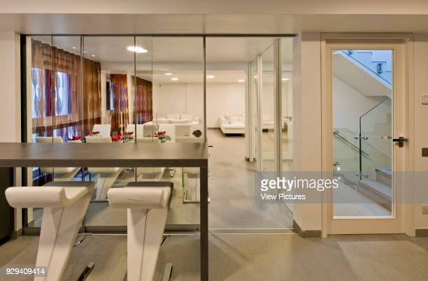 View from breakfast bar in kitchen to dining area and lounge Mews House Chagford Street London United Kingdom Architect Ayad LTuhafi Architects Ltd...