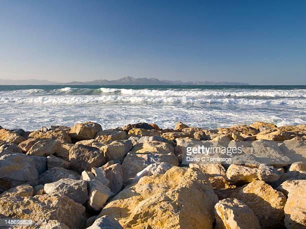 View from breakwater across the Badia dÆAlcudia towards Cap des Pinar and Cap de Formentor.
