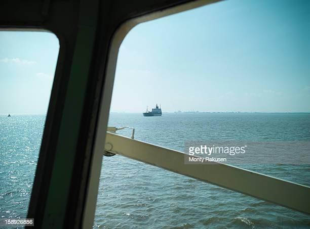 view from bridge of tugboat of ship in seascape - monty rakusen stock-fotos und bilder