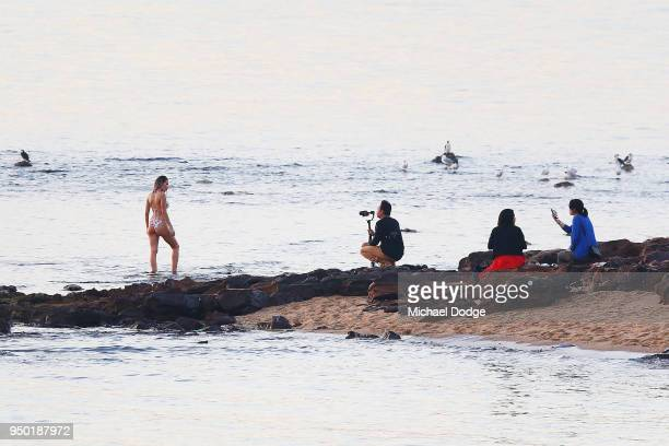 A view from Brighton foreshore is seen as as a beach goer poses during the evening of April 23 2018 in Melbourne Australia Melbourne has been...
