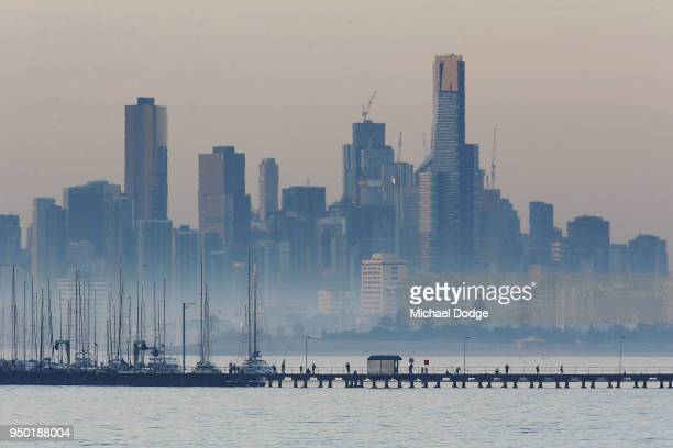 A view from Brighton marina is seen as people stroll during the evening of April 23 2018 in Melbourne Australia Melbourne has been experiencing...