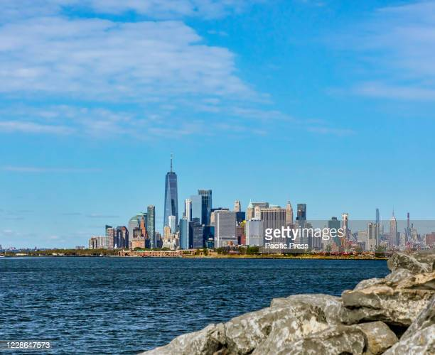 View from Brooklyn to Lower Manhattan skyline on a crisp Autumn day with plenty of blue sky.