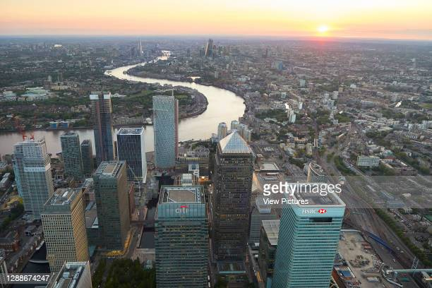View from Canary Wharf to City of London at sunset. 52 Lime Street - The Scalpel, London, United Kingdom. Architect: Kohn Pedersen Fox Associates ,...