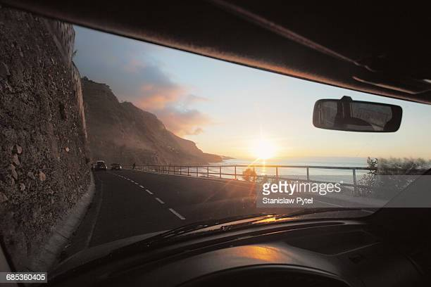 view from car on ocean at sunset - 海岸線 ストックフォトと画像