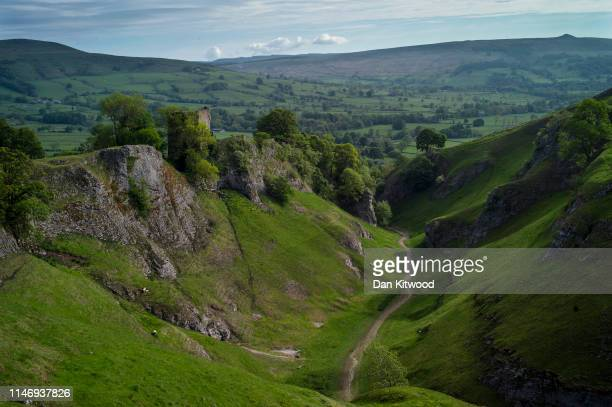 View from Cave Dale across the Peak District with Peveril Castle to the left on the morning of 'Castleton Garland Day' on May 29, 2019 in Castleton,...