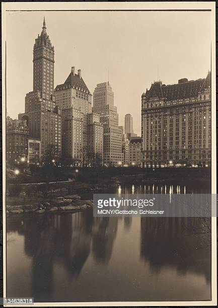 View from Central Park over the Pond and the buildings at 59th Street and Fifth Avenue at dusk with the Plaza Hotel Plaza Hotel | Pierre Hotel |...