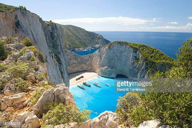 view from clifftop, navagio bay, zakynthos, greece - greece stock pictures, royalty-free photos & images