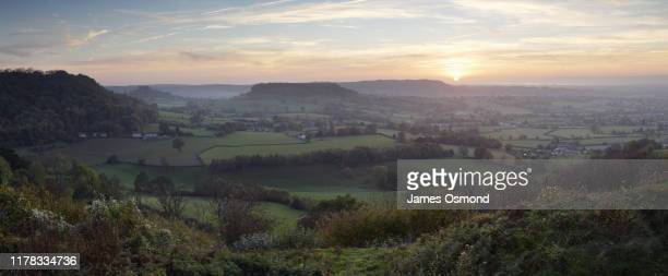 view from coaley peak towards cam long down at sunset. - gloucestershire stock pictures, royalty-free photos & images