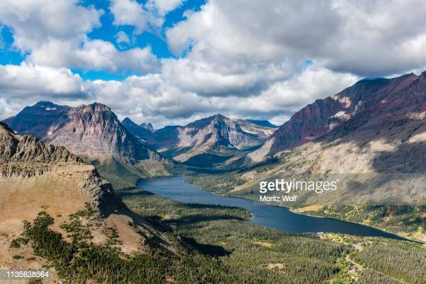 view from continental divide trail onto mountain lake two medicine lake with mountain landscape, sinopah mountain, glacier national park, montana, usa - two medicine lake montana stock photos and pictures