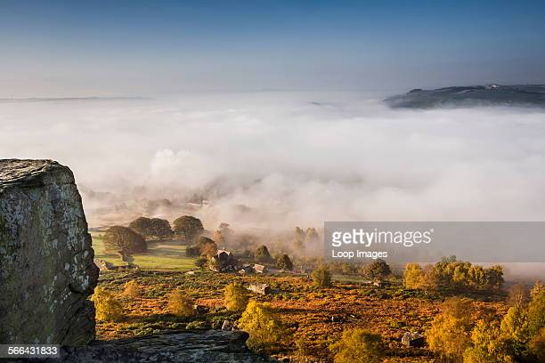 View from Curbar Edge in Derbyshire with autumn mist in the valley